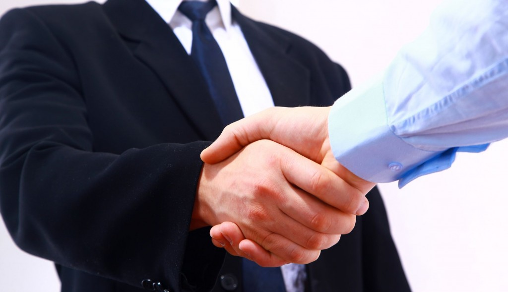 Handshake on Insurance Deal
