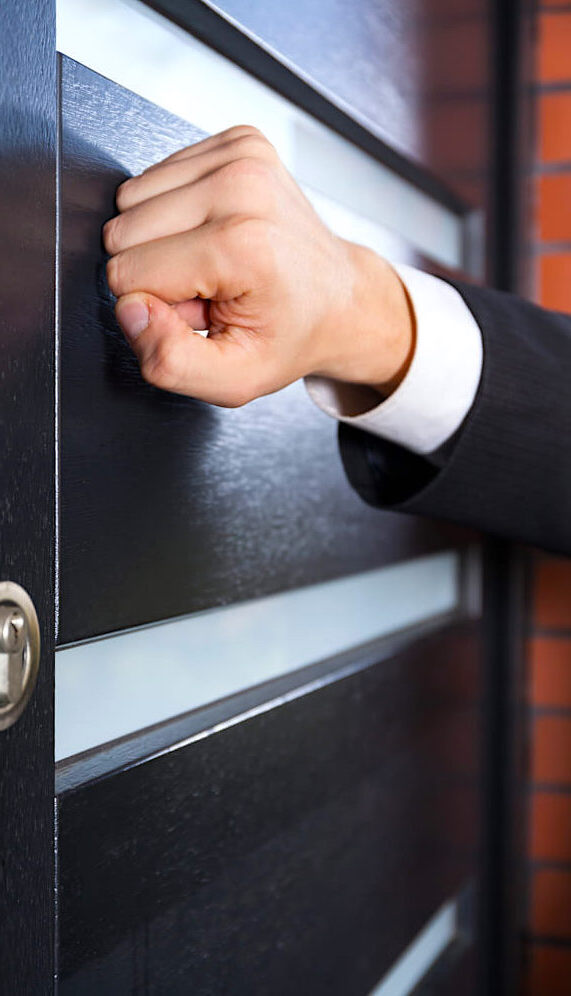 Insurance Adjuster Knocking on Homeowner's Door